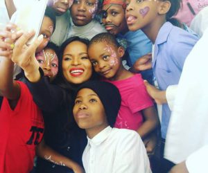 Bucie seen taking a super selfie with the children, who were smitten with her and taught her new dance moves.
