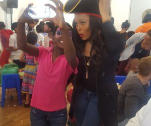 Bucie takes another selfie with an excited fan at Malaika Children's Orphanage.